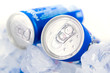Soda cans in ice with condensation - drink can