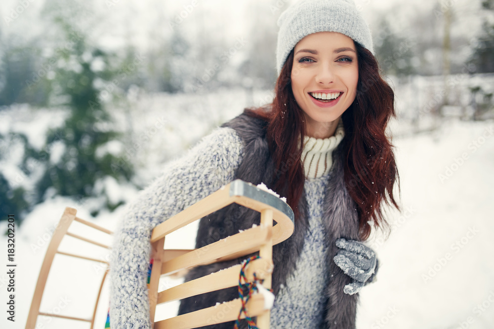 Fototapety, obrazy: Smiling young woman in wintertime outdoor. girl is having fun. Winter concept