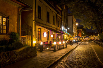 Fototapeta Kraków Jewish Quarter of the Kazimierz district in Krakow at night, Poland