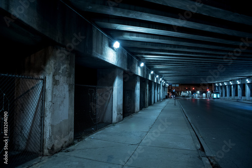 Canvas Prints Narrow alley Gritty dark Chicago city street with industrial train bridge viaduct tunnel at night.