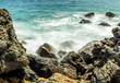 Waves hitting the rocks at Zuma Beach, long exposure, silk water - Zuma Beach, Los Angeles, LA, California, CA, USA