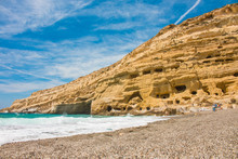 Matala, Beautiful Beach On Crete Island, Waves And Rocks.