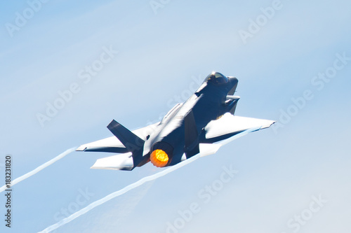 F-35 Lightning II in a high-G maneuver, with afterburner on and condensation tra Canvas Print
