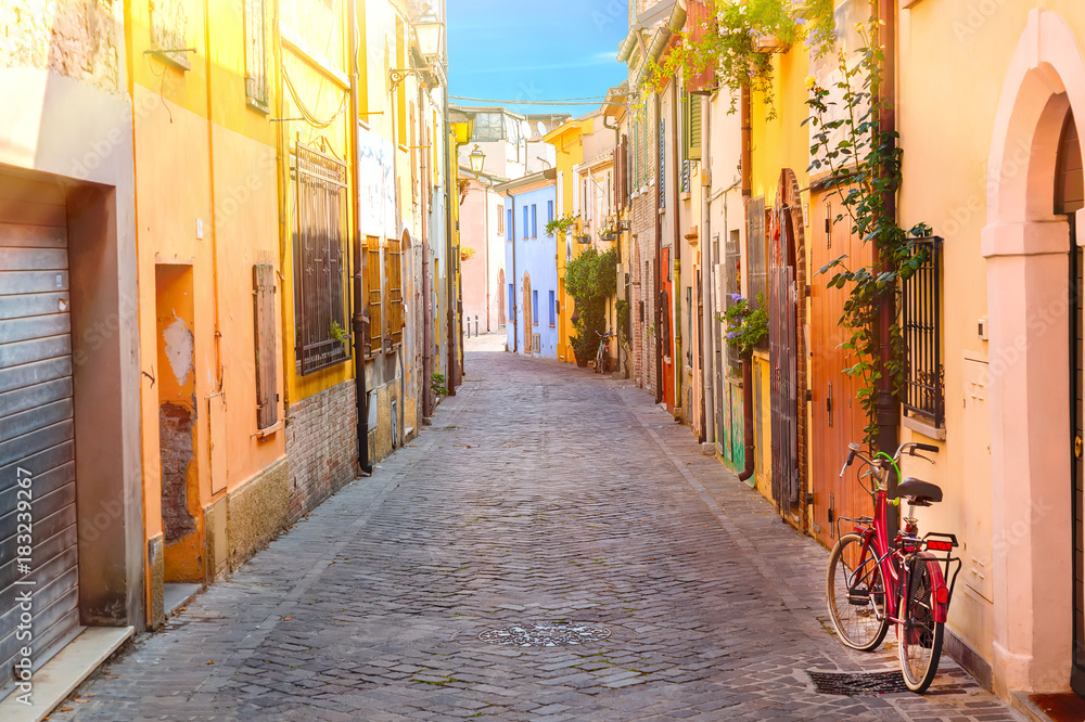 Fototapety, obrazy: Narrow street of the village of fishermen San Guiliano with colorful houses and a bicycle in early morning in Rimini, Italy
