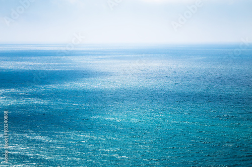 Staande foto Zee / Oceaan Beautiful seascape in the Atlantic ocean. Divine turquoise sea with white shimmering light on water and the blue shining sky