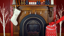 Cosy Christmas Holiday Decorated Mantelpiece And Fire Place In Red And White Theme
