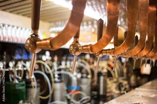 Papiers peints Bruxelles Beer bar pub tap, counter with blur pub background. Brussel Belgium