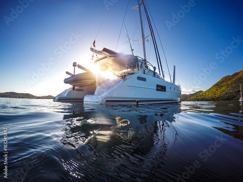Photo Stands Caribbean Sailing yacht catamaran sailing in the Caribbean sea