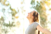 Woman Breathing Fresh Air Outd...