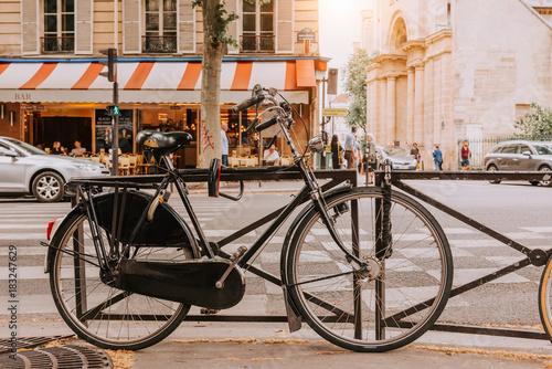 Old bicycle parked on Boulevard Saint-Germain in Paris, France Wallpaper Mural