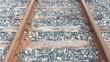 POV walking along railroad tracks looking down