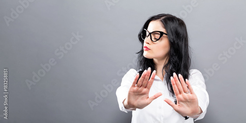 Fotografie, Obraz  Young woman making a rejection pose a solid background