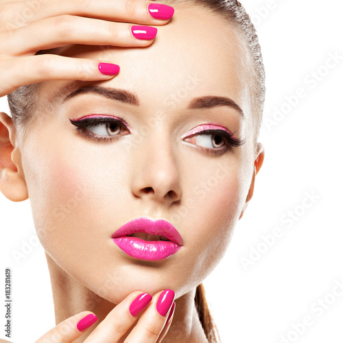 Fotografie, Obraz  eautiful woman face with pink makeup of eyes and nails.