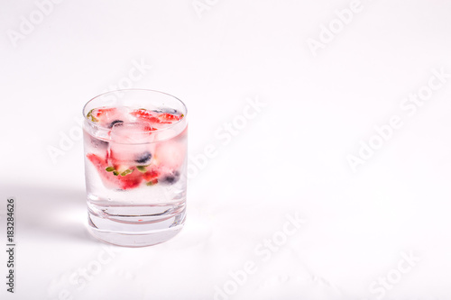 Fotografie, Obraz  Ice berries in glass of water