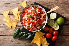 Mexican Appetizer Pico De Gallo Close-up In A Bowl. Horizontal Top View