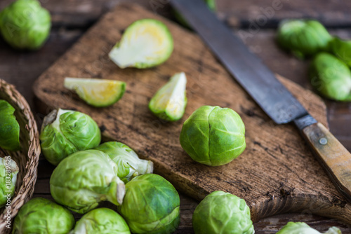 Foto op Canvas Brussel Fresh Brussels Sprouts on a Cutting Board