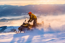 A Man Is Ridind Snowmobile In ...