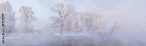 Staande foto Bleke violet amazing landscape with frozen snow covered trees at sunrise