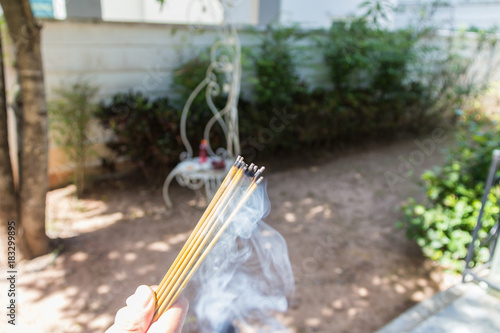 Fotografija incense burn with smock with food for workship at outside home