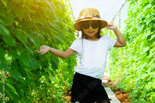 ace358ae Asian child girl wearing white t-shirt and black shorts with ...