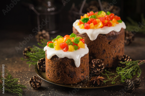 Deurstickers Dessert Traditional Christmas fruit cake on dark background