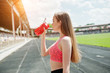 Fitness sporty girl in sportswear at stadium outdoor sports. Happy sexy woman drinking water from sport bottle mockup.
