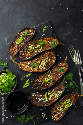 Spoed Foto op Canvas Natuur glazed grilled eggplants served with sesame seeds and green onion