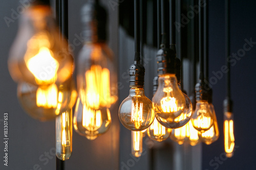 Photo  Diferent vintage tungsten filament lamps hanging from the ceiling