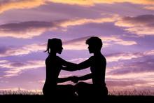 Man And Woman Doing Yoga At Su...