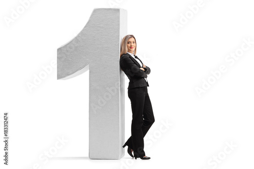 Formally Dressed Woman Leaning Against A Cardboard Number One Buy