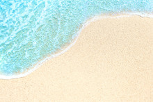 .Summer Beach And Soft Wave Background. Sand And Sea. Tropical Summer Vacation Concept With Copyspace