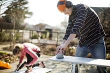 Couple Doing DIY In Garden