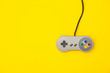 canvas print picture - Retro computer gaming controller on a bright yellow background