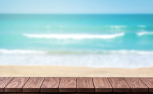 Empty Wooden Table With Blurred Beach Background