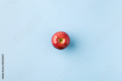 Obraz na plátně top view of ripe apple isolated on blue