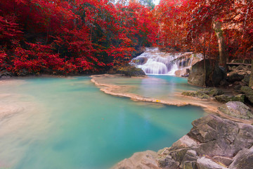 Fototapeta Waterfall at colorful autumn forest. Waterfall beautiful in southeast asia.