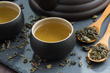 Pialas With Green Tea On A Dar...