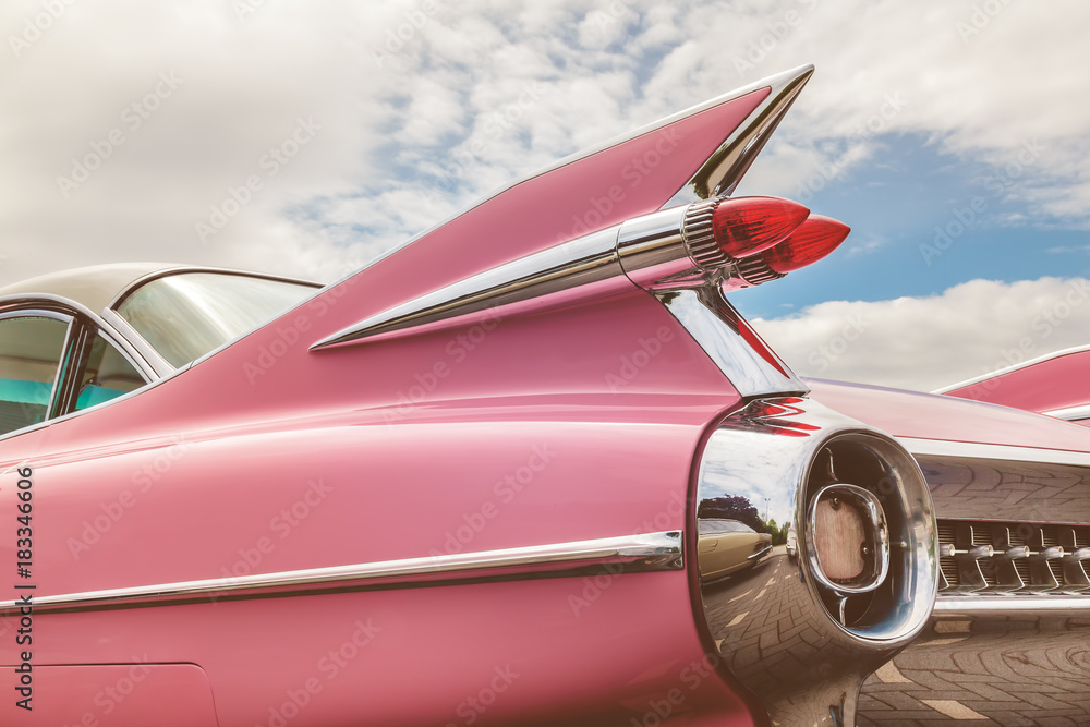 Fototapeta Rear end of a pink classic car