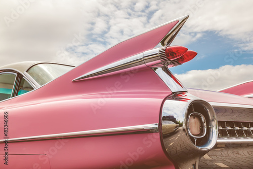 Keuken foto achterwand Vintage cars Rear end of a pink classic car