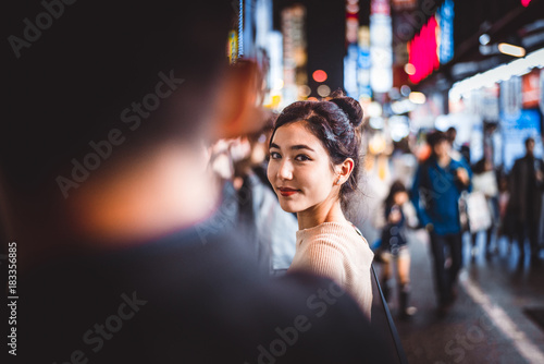 Tuinposter Aziatische Plekken Portrait of young woman outdoors by night, Tokyo, Japan