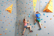 Young Boy And Instructor Climb...
