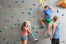 Instructors Helping Children C...
