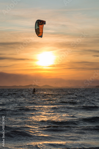 Papiers peints Nautique motorise Sunset over the sea or ocean and extreme freestyle sport kitesurfing