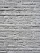 closeup of grey painted vertical part of brick wall