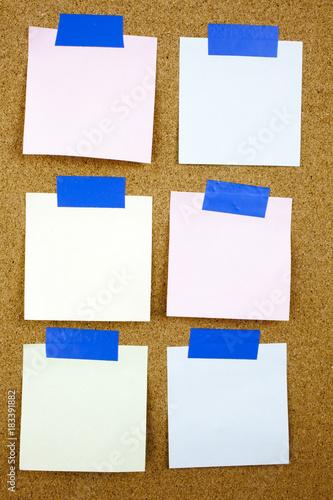 Fényképezés A yellow sticky note writing, caption, inscription Cork board with six blank colorful sticky notes