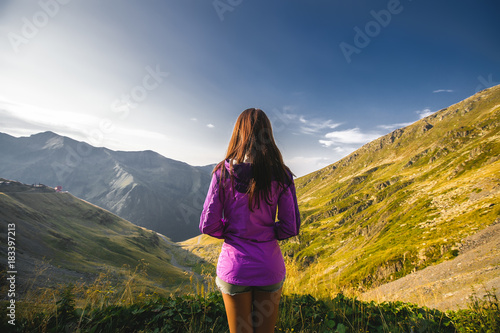 Cadres-photo bureau Bleu nuit Outdoor close up portrait stylish hipster girl behind amazing mountains landscapes,girl in sportswear, sexy model, girl hiking