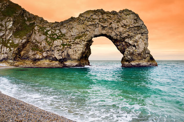 Panel Szklany Podświetlane Morze Durdle Door, natural limestone arch on the Jurassic Coast near Lulworth in Dorset, England.