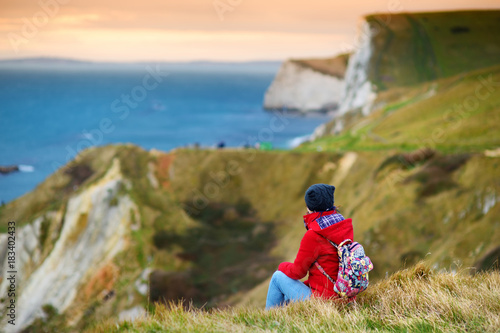 Tourist enjoying view of Man O'War Cove on the Dorset coast in southern England, Canvas Print