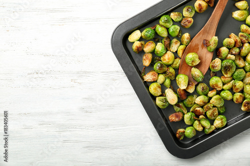 Photo Stands Brussels Baking sheet with roasted brussel sprouts on light background