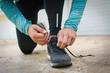 Tying shoelaces before running.